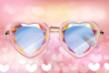 heart shaped sunglasses on a heart background
