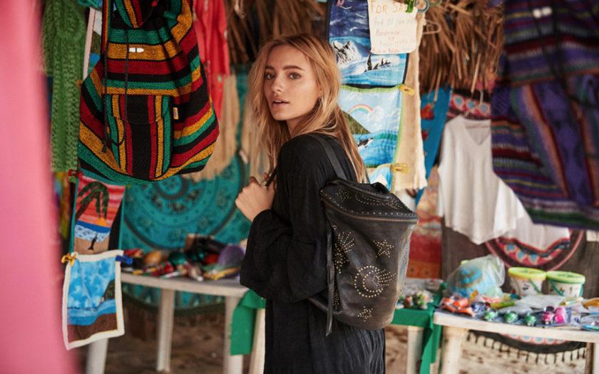 spiritual gangster x cleobella handbag on blonde model in an open air marketplace