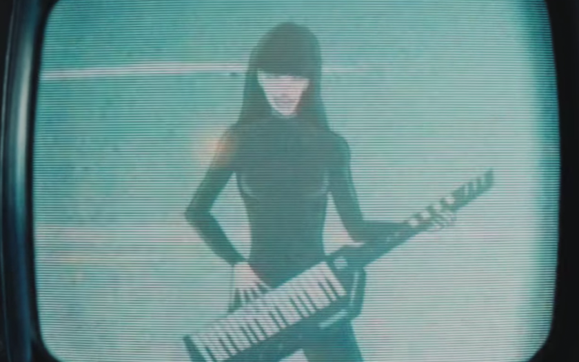 animation of kimbra holding a keyboard guitar synthesizer on an old timey TV set
