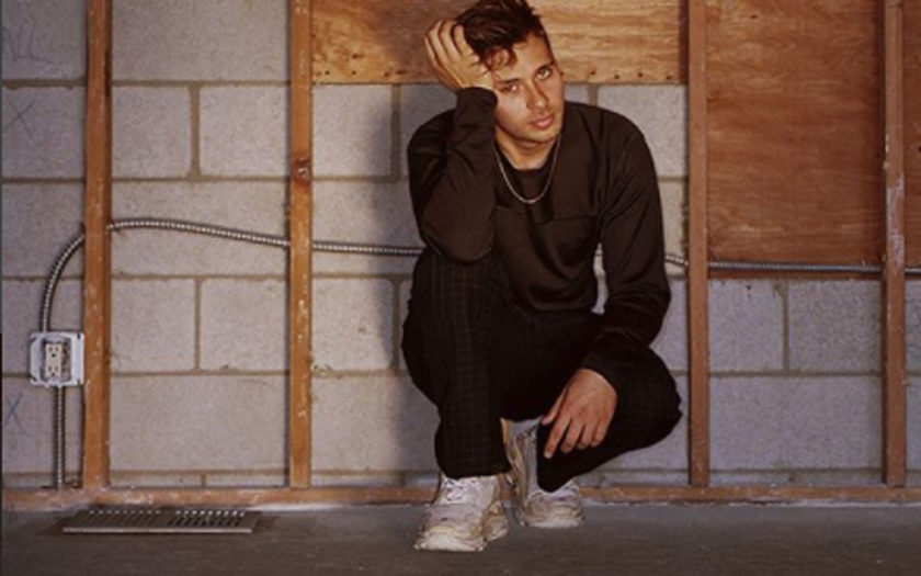 flume on one knee in a garage