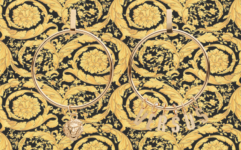 Versace versus logo hoop earrings on a trademark baroque background