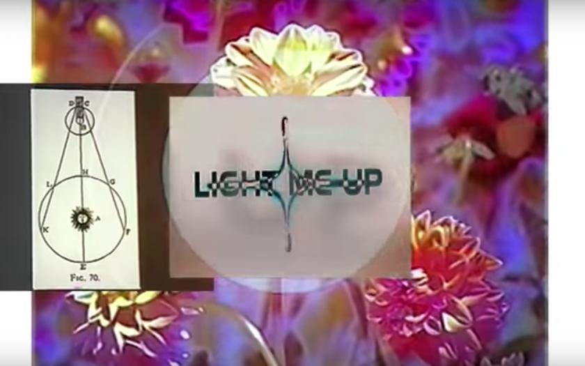 screenshot from light me up lyric video