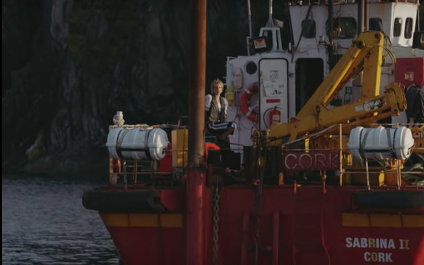 screenshot from sun in our eye music video of mo on a boat