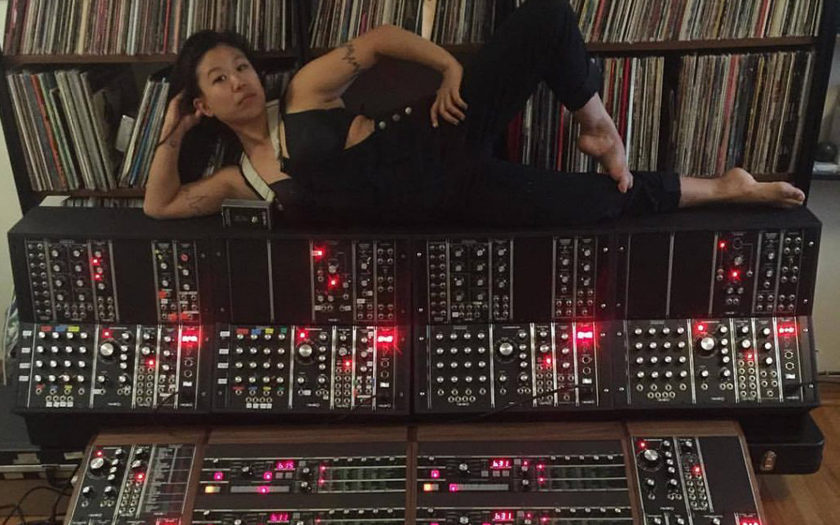 Nancy Wang of LCD Sound System on a large modular synthesizer
