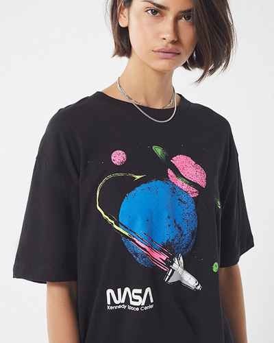 92ea86fef90 The Urban Outfitters NASA Tee ($34) is an oversized black tee with a retro  neon NASA logo. Wear it with shorts, black fishnet tights, sneakers or  ankle ...