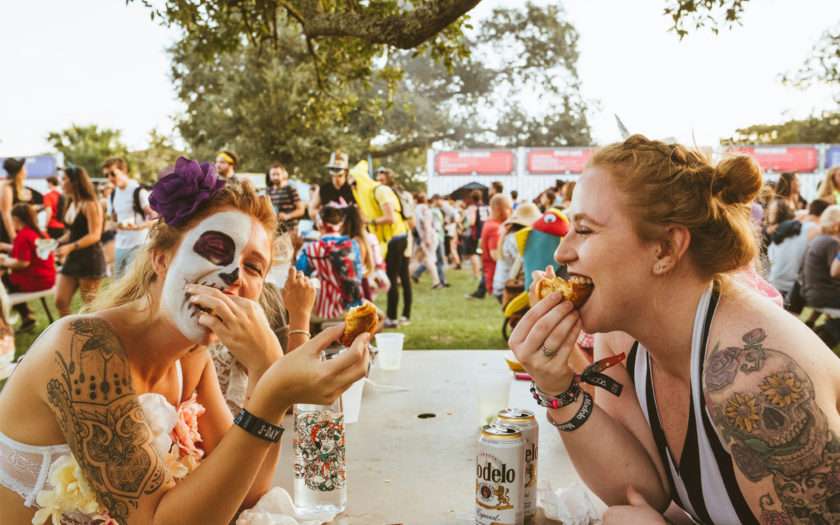 photo by Voodoo Experience Festival 2017 two girls eating food and drinking Modelo