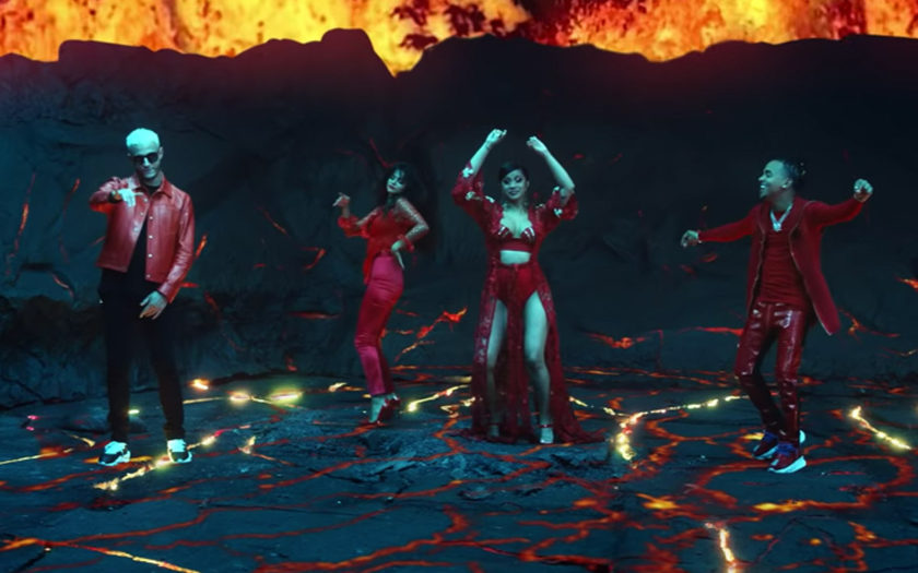 screenshot from taki taki music video of them dancing in a volcano