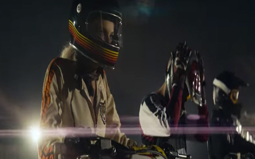 screenshot of dirtbike racers in This Feeling music video
