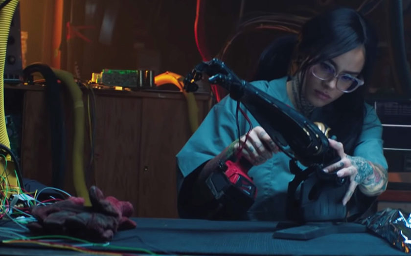 screenshot from nights like this video kehlani in a workshop building a robot arm