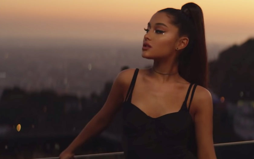 ariana grande on a los angeles balcony in the hills at sunset